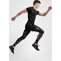 Getry do biegania męskie SPMF200 - czarny allover. Legginsy sportowe męskie marki KIPSTA. W wyprzedaży za 99.99 zł.