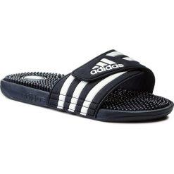 Klapki adidas - adissage 078261 N.Navy/N.Navy/Runwht. Klapki damskie Adidas, z tworzywa sztucznego. W wyprzedaży za 129.00 zł.