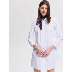 74f9e8ea55 Bawełniana tunika z haftem - Biały. Sukienki damskie marki Reserved. Za  139.99 zł.