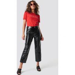 NA-KD Trend Lakierowane spodnie - Black. Czarne spodnie materiałowe damskie NA-KD Trend, z lakierowanej skóry. Za 181.95 zł.