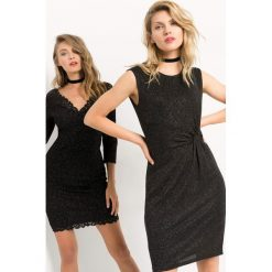 Sukienka z marszczeniem. Czarne sukienki damskie Orsay, z dzianiny, wizytowe, z okrągłym kołnierzem. Za 139.99 zł.