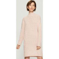 Dzianinowa sukienka oversize - Różowy. Czerwone sukienki damskie Sinsay, z dzianiny. Za 99.99 zł.