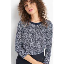 Koszulka w kwiaty. Czarne bluzki damskie Orsay, w kwiaty, z dzianiny, z okrągłym kołnierzem. Za 69.99 zł.