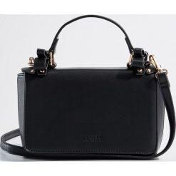 Torebka z odpinanym paskiem - Czarny. Czarne torebki do ręki damskie Mohito. Za 119.99 zł.