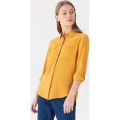 Koszula z kieszeniami - Żółty. Koszule damskie marki SOLOGNAC. Za 59.99 zł.