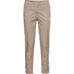 Spodnie 3/4 bonprix brunatny. Spodnie materiałowe damskie marki DOMYOS. Za 54.99 zł.