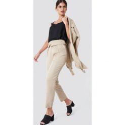 Trendyol Spodnie z wysokim stanem - Beige. Brązowe spodnie materiałowe damskie Trendyol, z lyocellu. Za 161.95 zł.
