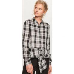 Koszula w kratę - Czarny. Koszule damskie marki SOLOGNAC. W wyprzedaży za 39.99 zł.