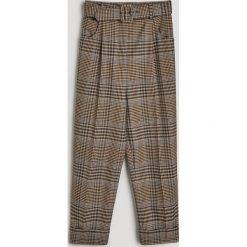 Spodnie w kratę - Wielobarwn. Spodnie materiałowe damskie marki DOMYOS. W wyprzedaży za 79.99 zł.