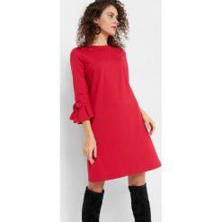 Trapezowa sukienka. Czerwone sukienki damskie Orsay, na lato, z dzianiny. Za 99.99 zł.