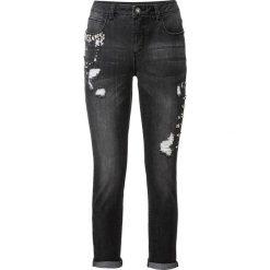 Dżinsy z kamieniami i efektami przetarcia bonprix czarny. Jeansy damskie marki bonprix. Za 99.99 zł.