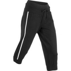 Spodnie sportowe 3/4, Level 1 bonprix czarny. Spodnie dresowe damskie marki Nike. Za 59.99 zł.