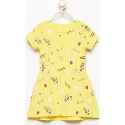 Bawełniana sukienka z nadrukiem - Żółty. Sukienki niemowlęce Reserved, z nadrukiem, z bawełny. W wyprzedaży za 14.99 zł.