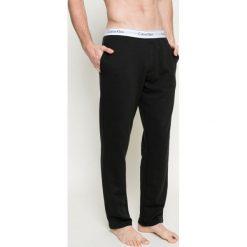 Calvin Klein Underwear - Spodnie piżamowe. Szare piżamy męskie Calvin Klein Underwear, z bawełny. W wyprzedaży za 219.90 zł.