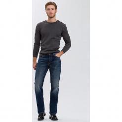 """Dżinsy """"Antonio"""" - Relax Fit - w kolorze granatowym. Niebieskie jeansy męskie Cross Jeans. W wyprzedaży za 136.95 zł."""