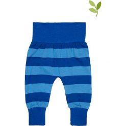 Spodnie w kolorze niebiesko-granatowym. Spodenki niemowlęce marki Toby Tiger. W wyprzedaży za 62.95 zł.