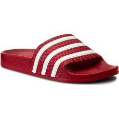 Klapki adidas - adilette 288193 Lgtsca/Wht/Lgtsca. Czerwone klapki damskie Adidas, w paski, ze skóry ekologicznej. Za 129.00 zł.