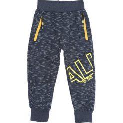 Granatowe Spodnie Dresowe Core. Niebieskie spodnie sportowe dla chłopców Born2be, z dresówki. Za 49.99 zł.