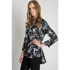 Czarno-biała bluzka we wzory BIALCON. Białe bluzki damskie BIALCON, w jednolite wzory, eleganckie, z asymetrycznym kołnierzem. Za 179.00 zł.
