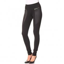 """Spodnie """"Mine"""" w kolorze czarnym. Czarne spodnie materiałowe damskie Assuili, ze skóry. W wyprzedaży za 113.95 zł."""