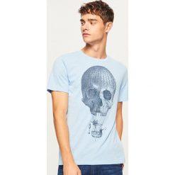 T-shirt z nadrukiem - Niebieski. Niebieskie t-shirty męskie Reserved, z nadrukiem. Za 29.99 zł.