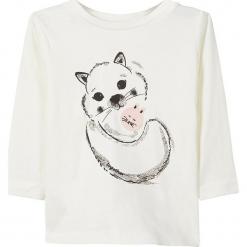 """Koszulka """"Sita"""" w kolorze białym. Białe bluzki dla dziewczynek Name it Baby, z nadrukiem, z bawełny, z okrągłym kołnierzem, z długim rękawem. W wyprzedaży za 25.95 zł."""