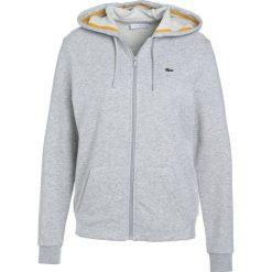 Lacoste Sport WOMEN TENNIS Bluza rozpinana light grey. Bluzy sportowe damskie Lacoste Sport, z bawełny. Za 409.00 zł.
