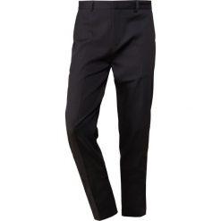LibertineLibertine TRANSWORLD Spodnie materiałowe black. Spodnie materiałowe męskie Libertine-Libertine, z bawełny. Za 569.00 zł.