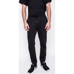 Puma - Spodnie Puma x XO The Weeknd. Szare spodnie sportowe męskie Puma, z bawełny. W wyprzedaży za 299.90 zł.