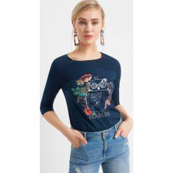 Koszulka z nadrukiem. Niebieskie bluzki damskie Orsay, z nadrukiem, z bawełny, z długim rękawem. Za 39.99 zł.