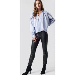 NA-KD Trend Spodnie z suwakiem PU - Black. Czarne spodnie materiałowe damskie NA-KD Trend, z materiału. Za 161.95 zł.