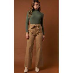 NA-KD Trend Szerokie spodnie z wywijanymi nogawkami - Beige. Brązowe spodnie materiałowe damskie NA-KD Trend. Za 202.95 zł.