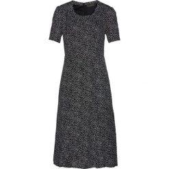Sukienka bonprix czarno-biały w kropki. Sukienki damskie marki DOMYOS. Za 129.99 zł.
