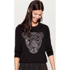 Sweter z połyskującą aplikacją - Czarny. Czarne swetry damskie Mohito. Za 99.99 zł.