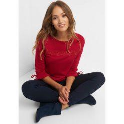 Koszulka z koronkową wstawką. Czerwone bluzki damskie Orsay, w jednolite wzory, z dzianiny, z falbankami, z długim rękawem. Za 69.99 zł.