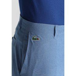 Lacoste Sport RYDER CUP Spodnie materiałowe blue. Spodnie sportowe męskie Lacoste Sport, z elastanu, sportowe. Za 559.00 zł.