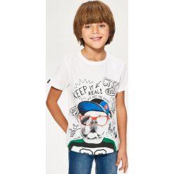 T-shirt z kolorowym nadrukiem - Biały. T-shirty damskie marki Reserved. W wyprzedaży za 39.99 zł.