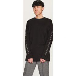 Bluza z nadrukiem - Czarny. Czarne bluzy dla chłopców Reserved, z nadrukiem. Za 49.99 zł.