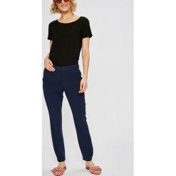 Tommy Jeans - Spodnie. Szare jeansy damskie Tommy Jeans. W wyprzedaży za 319.90 zł.