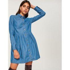 Jeansowa sukienka - Niebieski. Niebieskie sukienki damskie Reserved, z jeansu. W wyprzedaży za 49.99 zł.