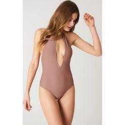 NA-KD Swimwear Kostium kąpielowy wiązany na szyi - Pink. Różowe kostiumy jednoczęściowe damskie NA-KD Swimwear. Za 121.95 zł.