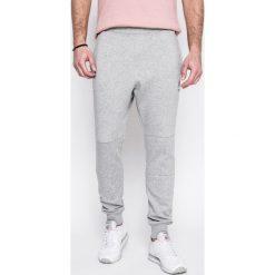 Reebok Classic - Spodnie. Szare spodnie sportowe męskie Reebok Classic, z bawełny. W wyprzedaży za 159.90 zł.