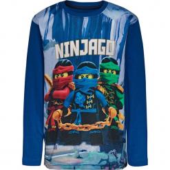 Koszulka w kolorze niebieskim. Niebieskie t-shirty dla chłopców marki Lego Wear Fashion, z nadrukiem, z bawełny, z długim rękawem. W wyprzedaży za 42.95 zł.