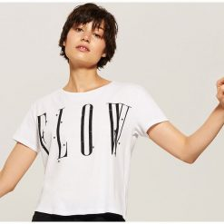 T-shirt z napisem - Biały. T-shirty damskie marki DOMYOS. W wyprzedaży za 19.99 zł.