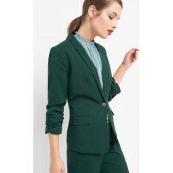 Taliowany żakiet. Zielone żakiety damskie Orsay, z elastanu. Za 169.99 zł.