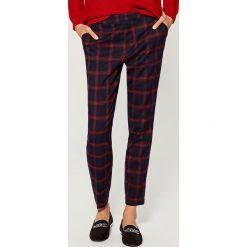 Spodnie cygaretki - Niebieski. Niebieskie spodnie materiałowe damskie Mohito. Za 99.99 zł.