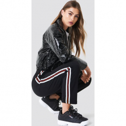 Trendyol Spodnie joggersy z lampasami - Black. Czarne spodnie materiałowe damskie Trendyol, z elastanu. Za 121.95 zł.