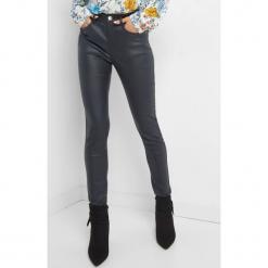Woskowane spodnie skinny. Niebieskie spodnie materiałowe damskie Orsay, z denimu. Za 79.99 zł.