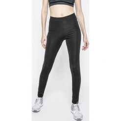Adidas Originals - Legginsy. Szare legginsy damskie adidas Originals, z aplikacjami, z dzianiny. W wyprzedaży za 129.90 zł.