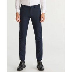 Eleganckie spodnie slim fit - Granatowy. Eleganckie spodnie męskie marki Giacomo Conti. W wyprzedaży za 99.99 zł.